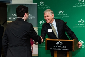 Professor Amato shaking hands with student